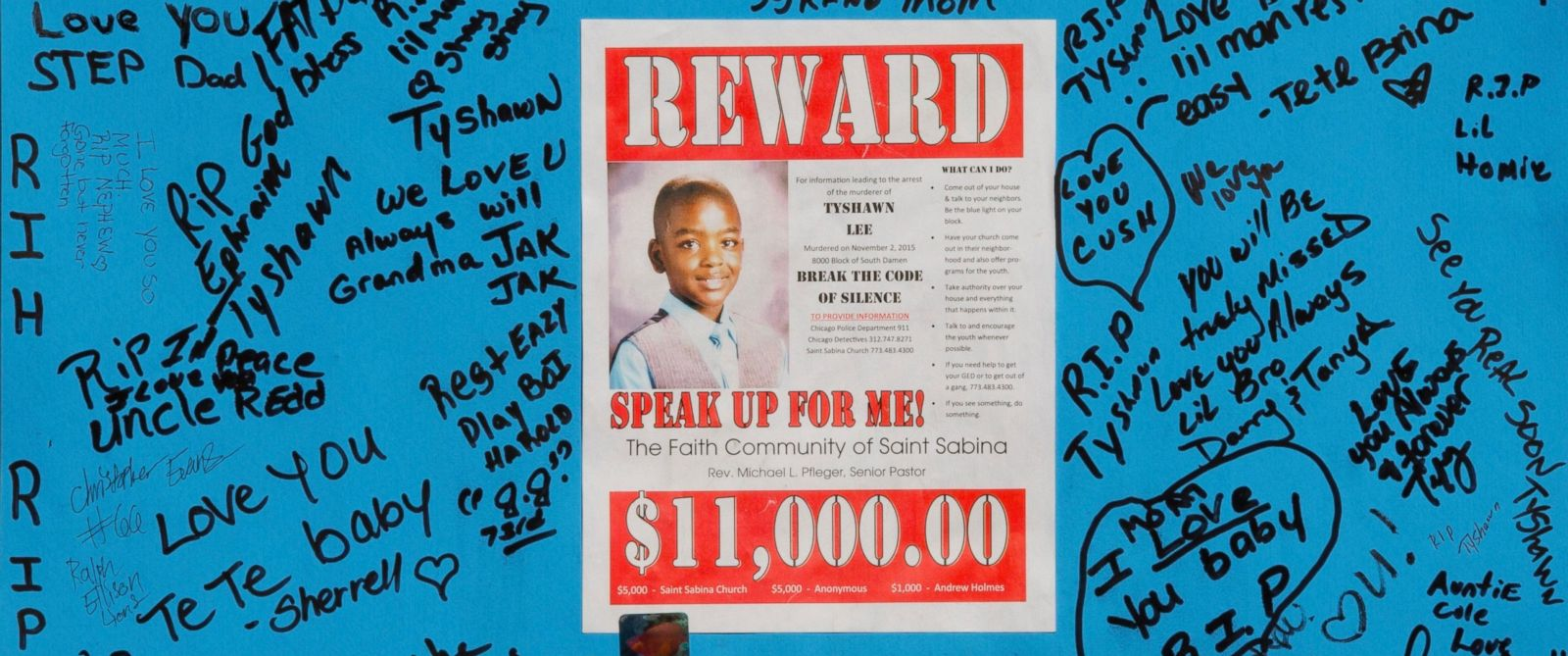 A reward sign and messages hang near the site where 9-year-old Tyshawn Lee was fatally shot Nov. 2, 2015, in Chicago. On March 7, 2016, Dwight Boone-Doty, 22, was charged with first-degree murder in Tyshawns death.