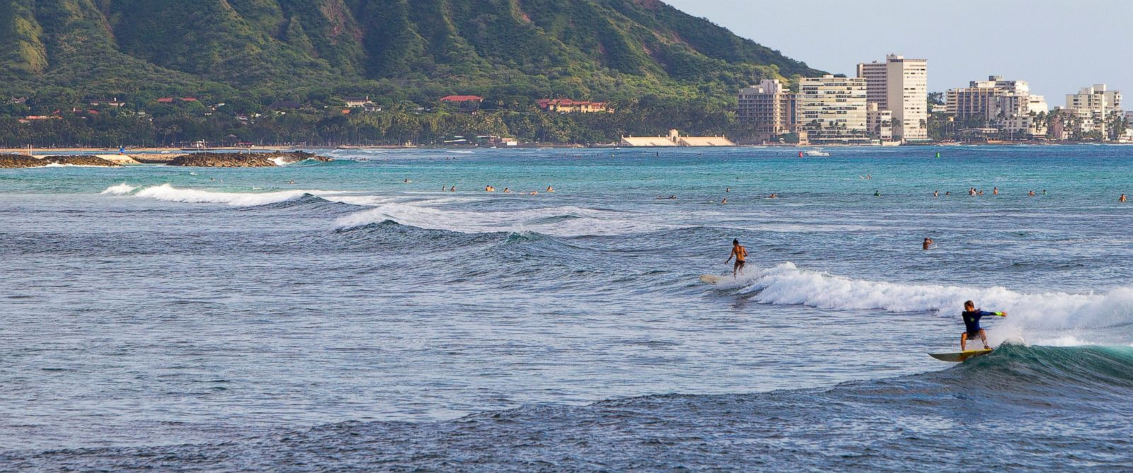 PHOTO: This Nov. 4, 2014 file photo shows surfers off Ala Moana Beach Park, in Honolulu with Diamond Head mountain in the background.