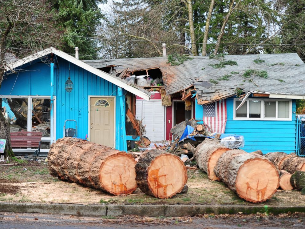 PHOTO:A house in Southeast Portland, Ore., lies in ruins, Dec. 9, 2015, after a tree collapsed killing a 60-year-old woman in the early hours of the morning. Heavy rain and winds have battered the region causing widespread flooding and power outages.