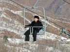 PHOTO: North Korean leader Kim Jong-un aboard a ski lift during his inspection tour at the Masik Pass ski resort, near Wonsan, North Korea, Dec. 31, 2013.