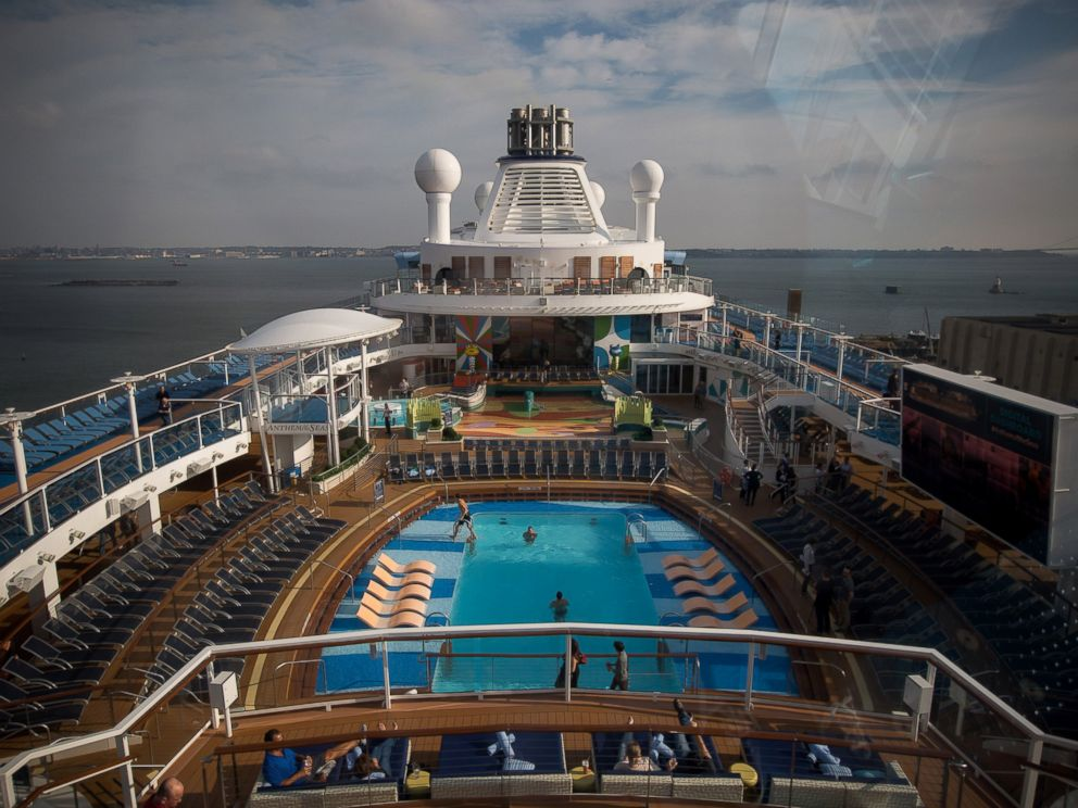 PHOTO: Guests relax on the deck of the Royal Caribbean Cruises Ltd. Quantum-class cruise ship, the Anthem of the Sea, at the Cape Liberty Cruise Port in Bayonne, N.J. on Oct. 6, 2015.