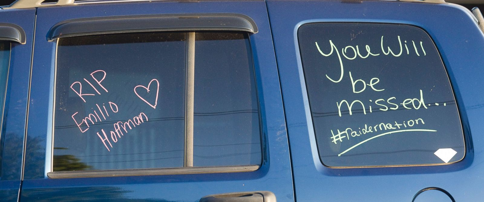 "PHOTO: A students car bears the message to ""RIP Emilio Hoffman"" as its parked near a church holding a vigil to pray for the victims of todays school shooting, June 10, 2014, in Gresham, Oregon."