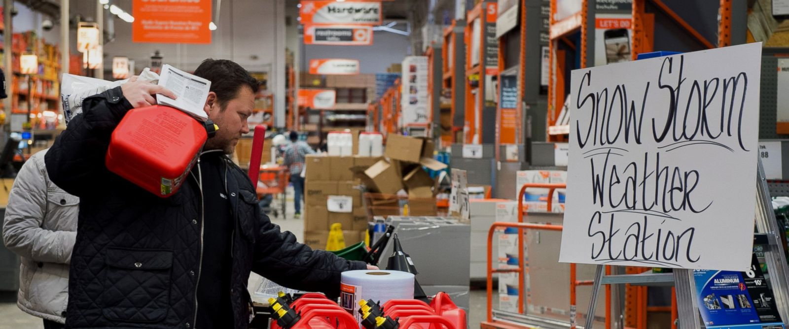 PHOTO: A customer shops for supplies to prepare for the winter storm at a Home Depot Inc. store in Secaucus, N.J. on Jan. 26, 2015.