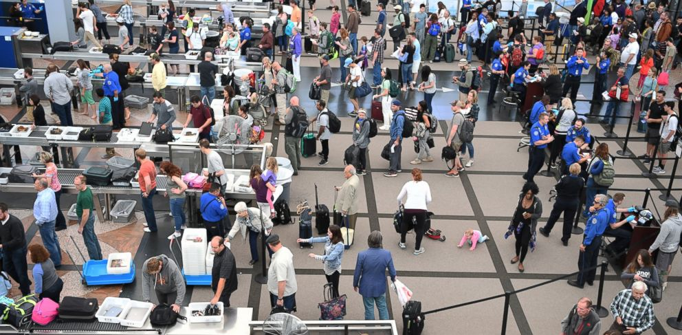 PHOTO:Travelers, at Denver International Airport, make there way through security lines as people start traveling for the long Memorial Day weekend, May 26, 2016.