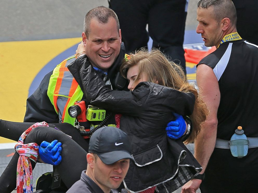 PHOTO: Victim Victoria McGrath is helped to a stretcher by emergency personnel after two explosions went off near the finish line of the 117th Boston Marathon on April 15, 2013.