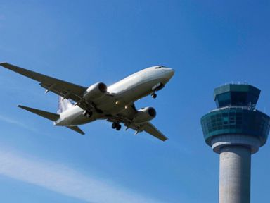 PHOTO: A plane flies past a control tower in this file photo.