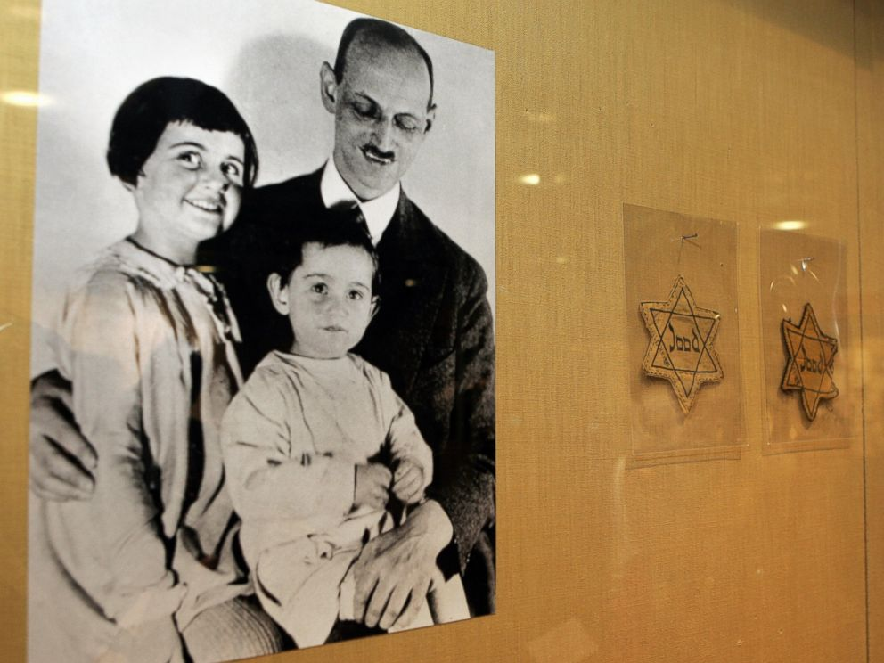 PHOTO: A photograph of Otto Frank with his daughters Anne, center, and Margaret, left, with yellow stars worn by Dutch Jews is shown over a display of documents discovered in the YIVO Institute for Jewish Research archives, Feb. 14, 2007, in New York.