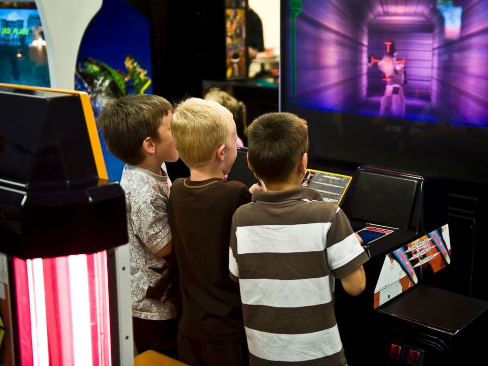 PHOTO: Boys playing a video game in an arcade are seen in this undated file photo.