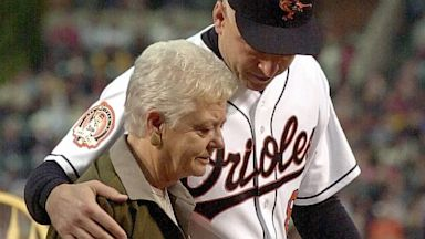 "PHOTO: ""Iron Man"" Cal Ripken walks with his mother Vi Ripken"