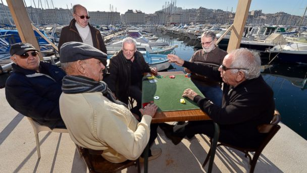 """PHOTO: Men play cards, January 7, 2013, in the Vieux Port of Marseille (Marseilles old harbor), southern France, a week before the launching, January 12, 2013, of """"Marseille-Provence European Capital of Culture"""" in 2013."""