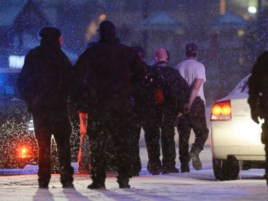PHOTO: Police escort a shooting suspect out of a armored vehicle at the intersection of Centennial and Fillmore in Colorado Springs, Colo., Nov. 27, 2015.
