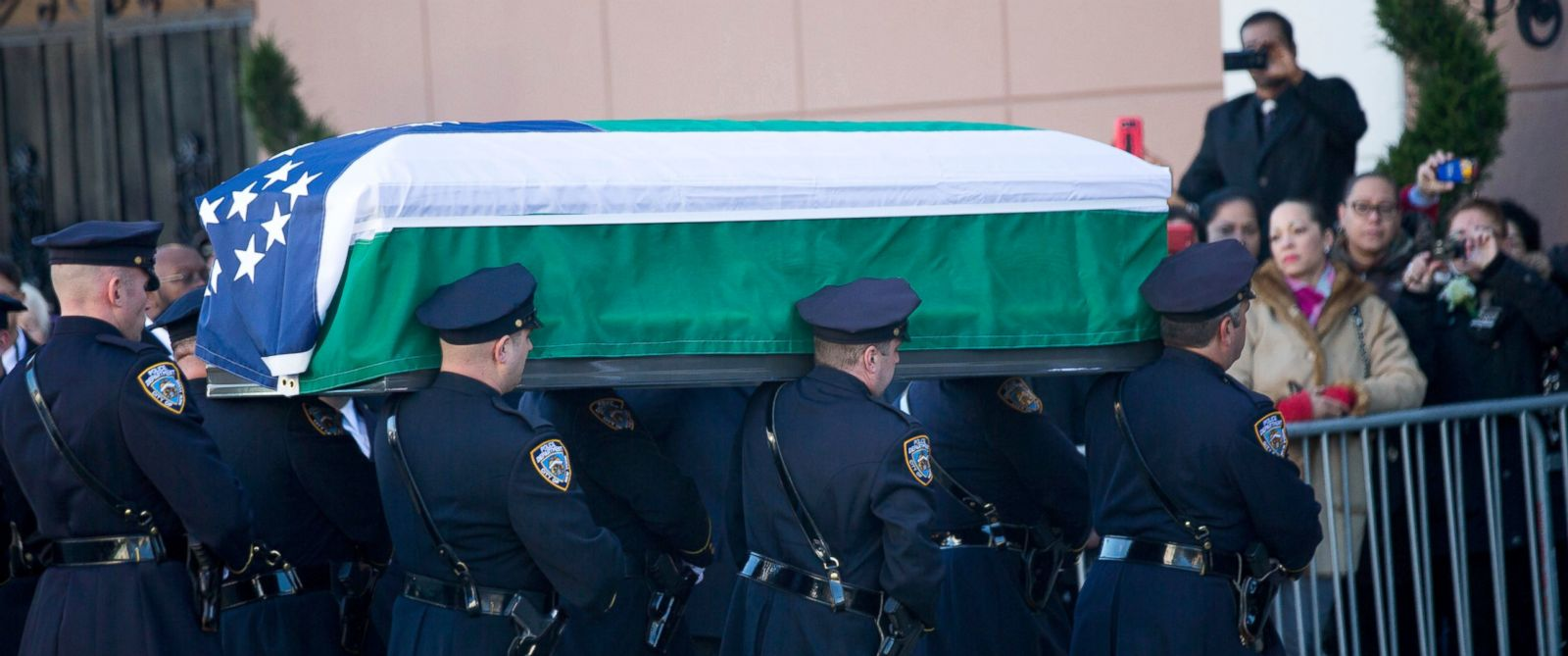 PHOTO: The casket of New York City police officer Rafael Ramos is carried into Christ Tabernacle Church prior to his wake, Dec. 26, 2014, in the Glendale, New York City.
