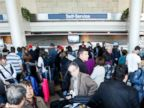 PHOTO: Passengers crowd the American Airlines Terminal at LAX on April 16, 2013.