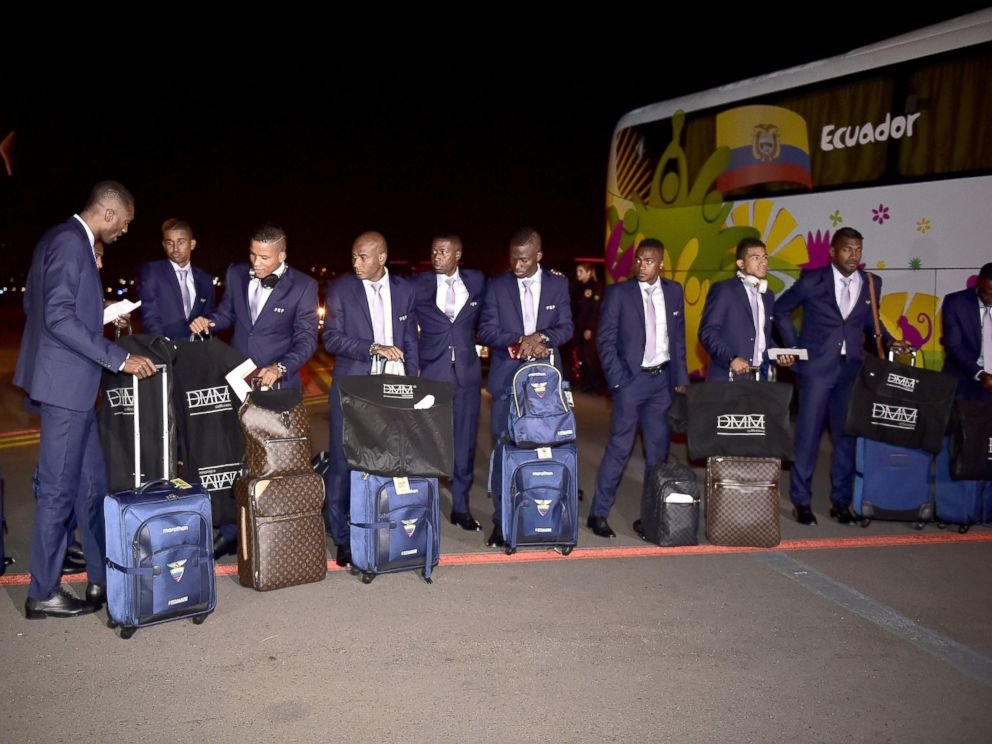 PHOTO: Ecuadors national football team players wait to board the team bus upon their arrival at Salgado Filho International Airport, June 9, 2014, ahead of the 2014 FIFA World Cup.