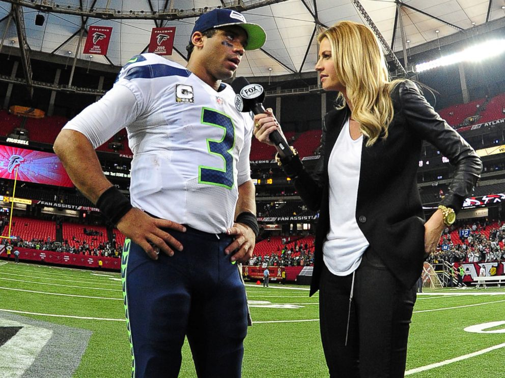 PHOTO: Russell Wilson of the Seattle Seahawks is interviewed by Erin Andrews after the game against the Atlanta Falcons at the Georgia Dome, Nov. 10, 2013 in Atlanta.