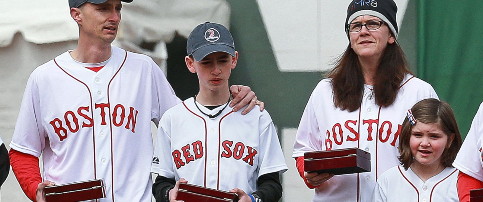 PHOTO: The family of Boston Marathon bombing victim Martin Richard carries the 2013 World Series championship rings