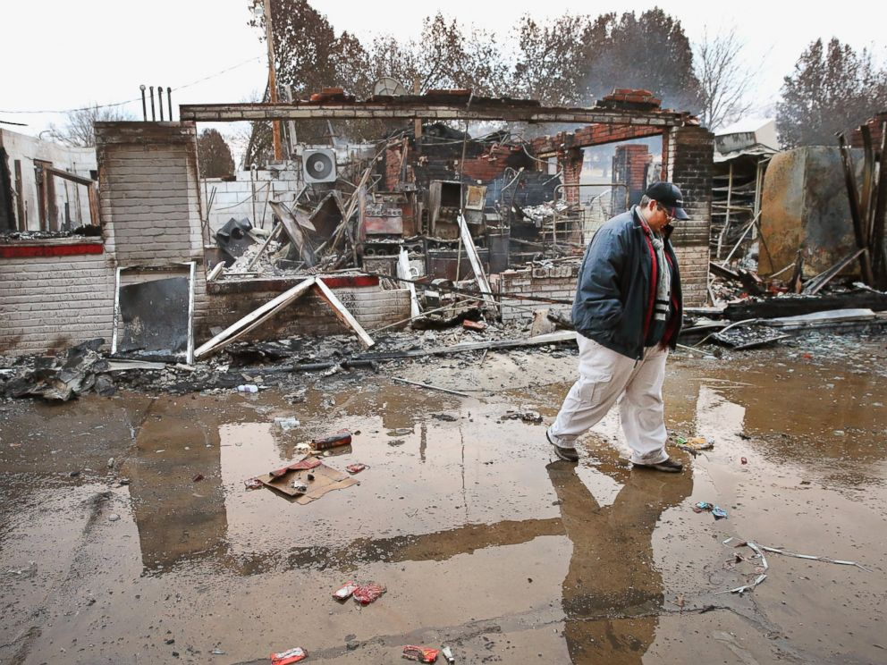 PHOTO: Property manager Terri Willits looks over a gas station she manages that was set on fire when rioting erupted following the grand jury announcement in the Michael Brown case, Nov. 25, 2014 in Dellword, Mo.