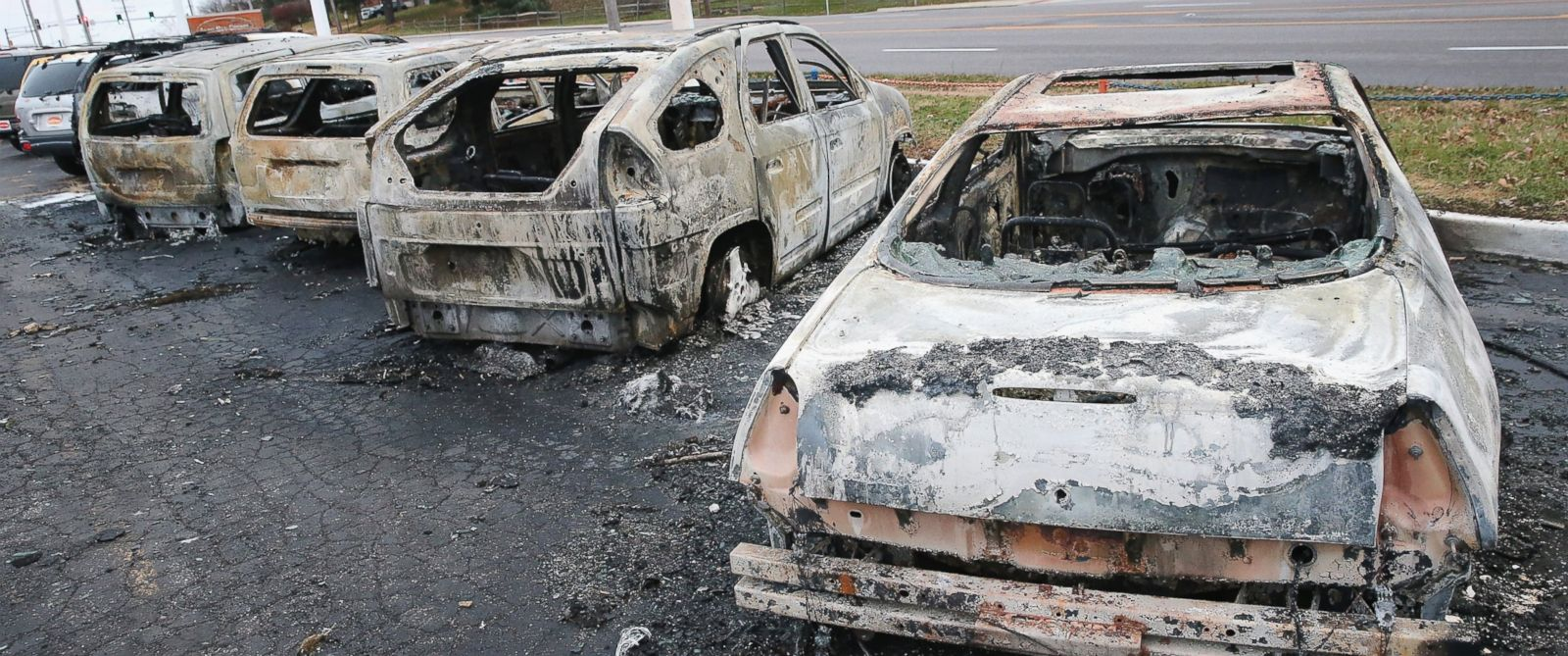 PHOTO: Cars which were set on fire when rioting erupted following the grand jury announcement in the Michael Brown case sit on a lot, Nov. 25, 2014 in Dellword Mo.