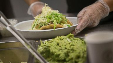 PHOTO: Chipotle Mexican Grill Inc. employees prepare food at a location in New York, Oct. 17, 2012.