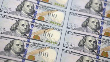 PHOTO: A sheet of uncut $100 bills.
