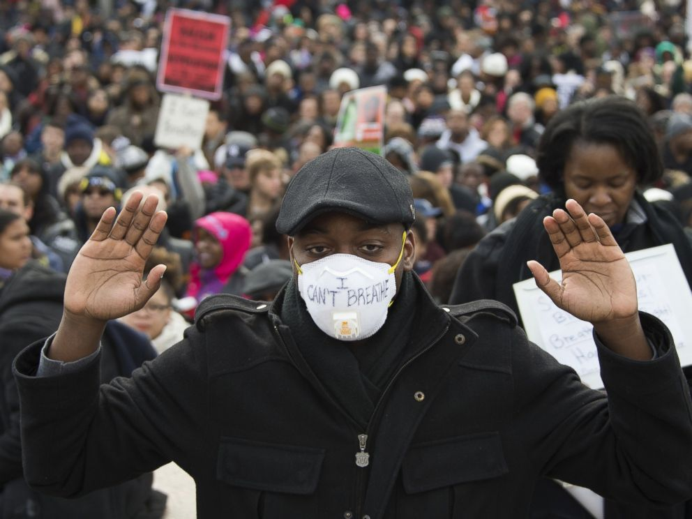 PHOTO: Preston Miller holds his hands up during the Justice For All march in Washington, Dec. 13, 2014.