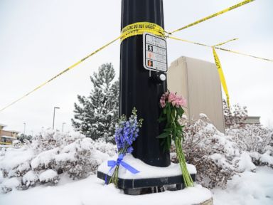 PHOTO: Flowers are laid on the corner as a memorial at Fillmore Street and Centennial Boulevard on Nov. 28, 2015 in Colorado Springs, Colo.