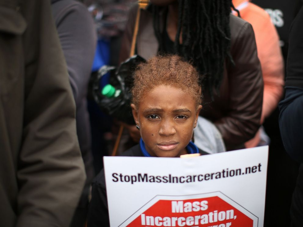PHOTO: Nine-year-old Bill Jackson joins demonstrators, inspired by the August 9 death of Michael Brown in Ferguson, Mo., in a march through downtown to protest racial injustice, Oct. 11, 2014 in St. Louis.