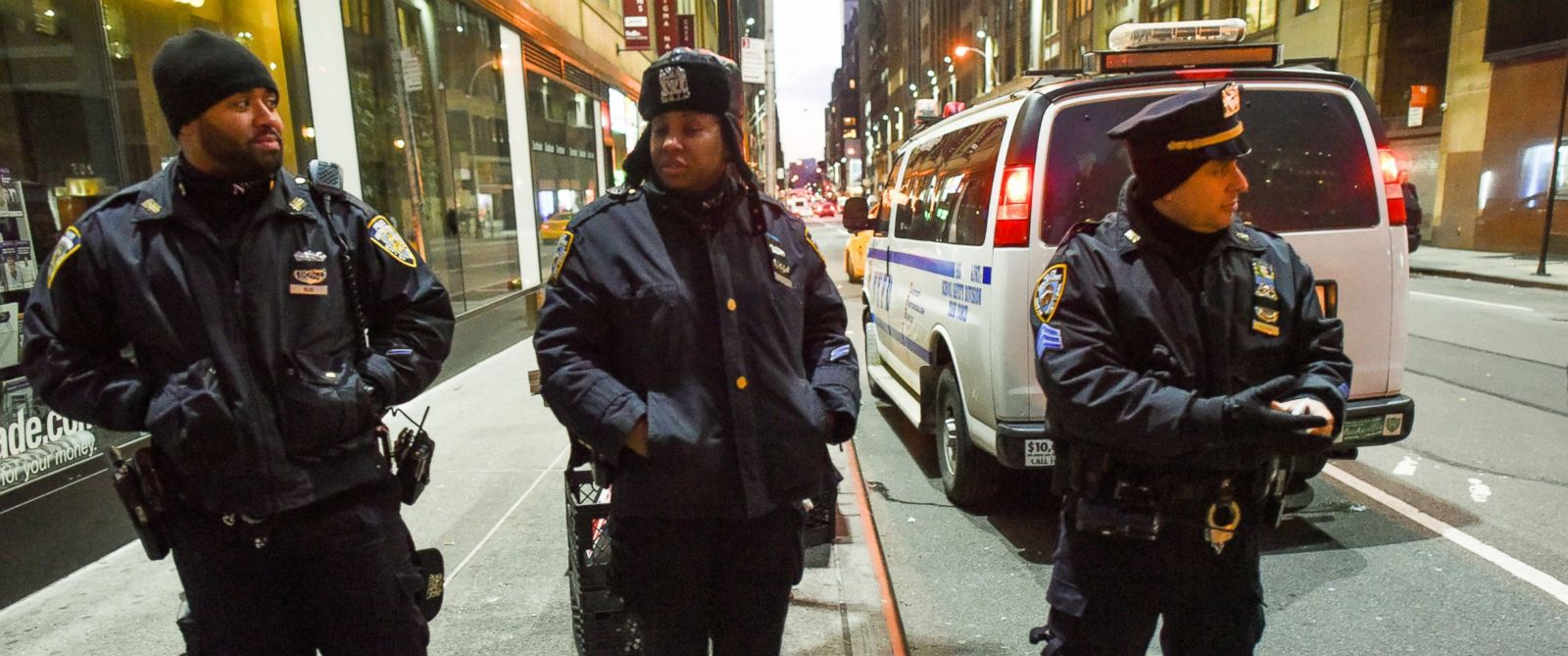 PHOTO: Officers of the New York Police Department stand watch on 42nd Street in Times Square on Dec. 31, 2014 in New York City.