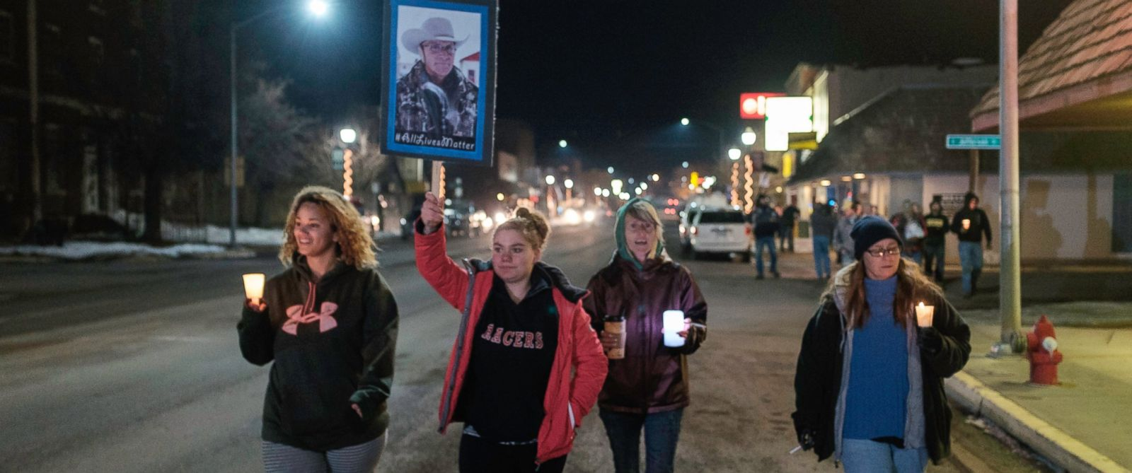 "PHOTO: A group of more than 20 people marched up and down N. Broadway Avenue in Burns, Ore., Jan. 27, 2016, holding a candlelight celebration of the life for Robert ""LaVoy"" Finicum. Finicum was killed Jan. 26, 2016."