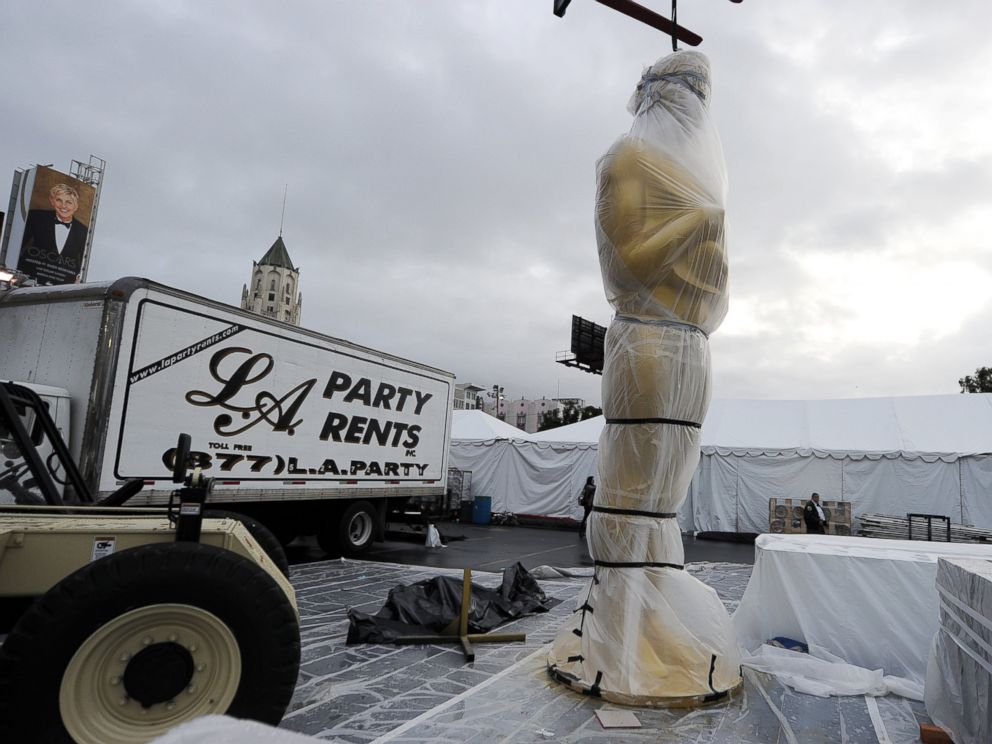 PHOTO: An Oscar statue is covered in plastic near the red carpet as preparations continue for the 86th Annual Academy Awards, March 1, 2014, in Hollywood, Calif.