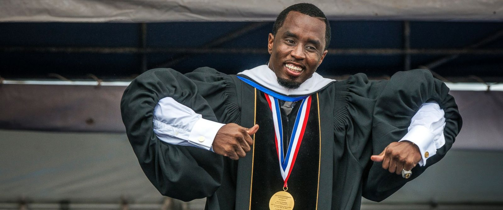 PHOTO: Sean Combs does a little dance across the stage while he delivers his keynote address during Howard Universitys commencement ceremonies, May, 10, 2014 in Washington.