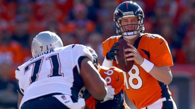 PHOTO: Peyton Manning looks to pass in the first quarter against the New England Patriots during the AFC Championship game, Jan. 19, 2014, in Denver.