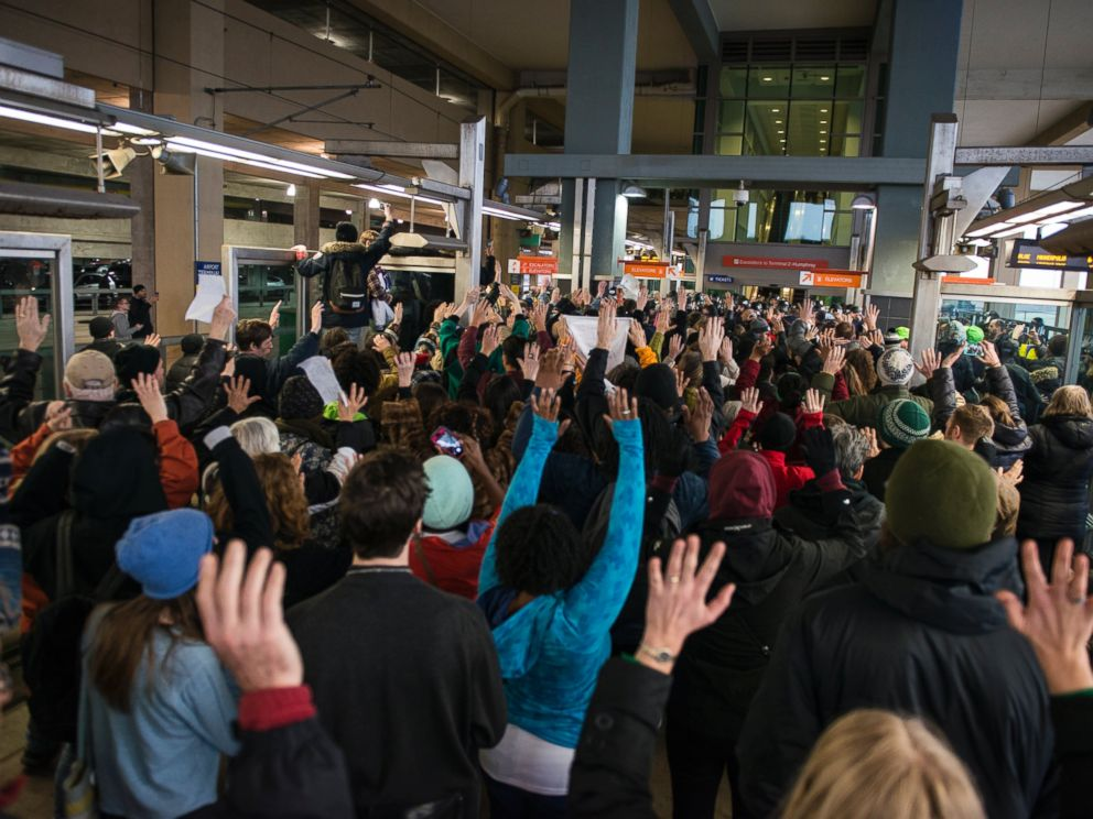 PHOTO: Black Lives Matter protesters hold their hands in the air and chant, Hands up, dont shoot, at the Minneapolis-St. Paul International airport Lightrail stop, Dec. 23, 2015 in Minneapolis.