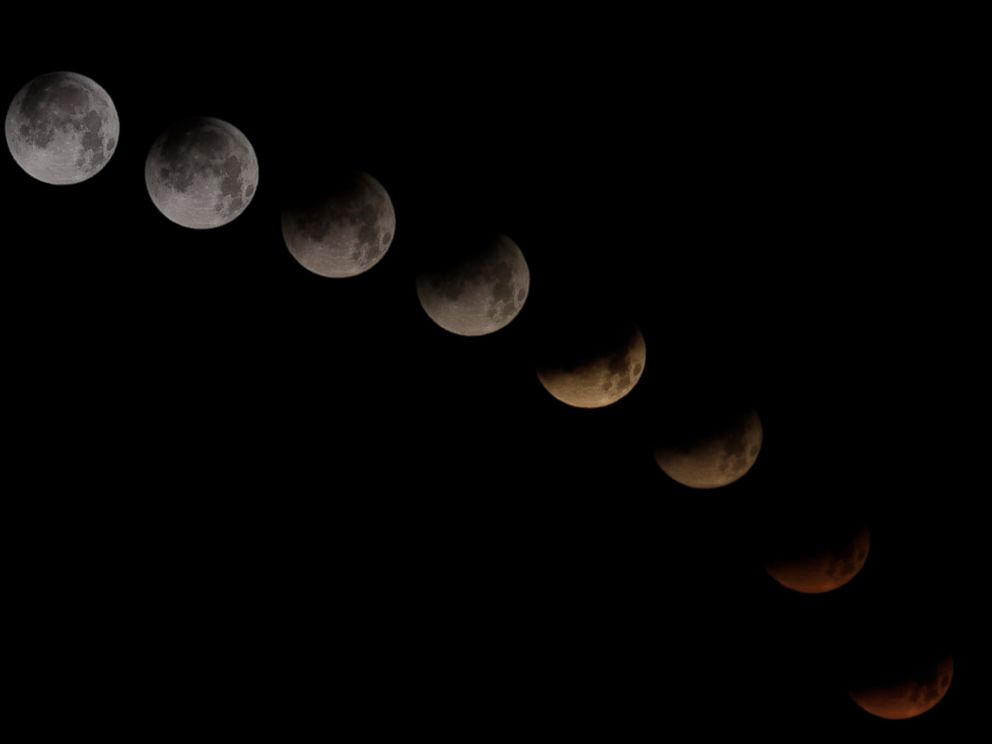 PHOTO: A combination of 10 pictures shows the moon in different stages of a total lunar eclipse seen from the Spanish Canary Island of Tenerife, April 15, 2014.