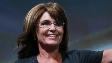 PHOTO: Former Alaska Gov. Sarah Palin waves before speaking during the 2013 NRA Annual Meeting and Exhibits at the George R. Brown Convention Center, May 3, 2013 in Houston.