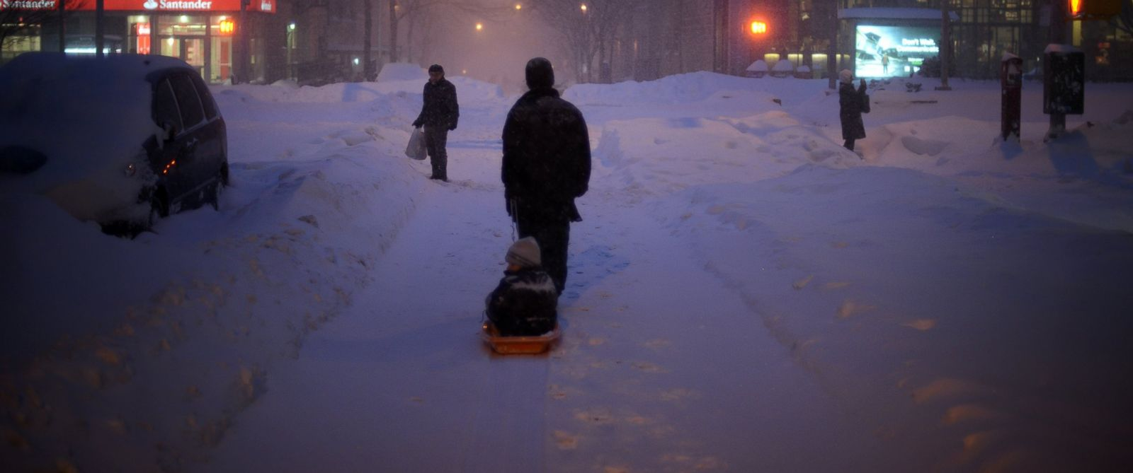 PHOTO:A young child is pulled home along West 82 Street which is covered in snow after a day of constant snow, Jan. 23, 2016, in New York.
