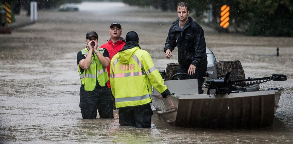 PHOTO: Residents and first responders launch boats to rescue people trapped in their homes Oct. 4, 2015 in Columbia, S.C.