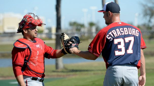 PHOTO: Washington Nationals starting pitcher Stephen Strasburg, right, greets catcher Jhonatan Solano, left, after their bullpen session during spring training workouts on Feb. 16, 2014 in Viera, Fla.