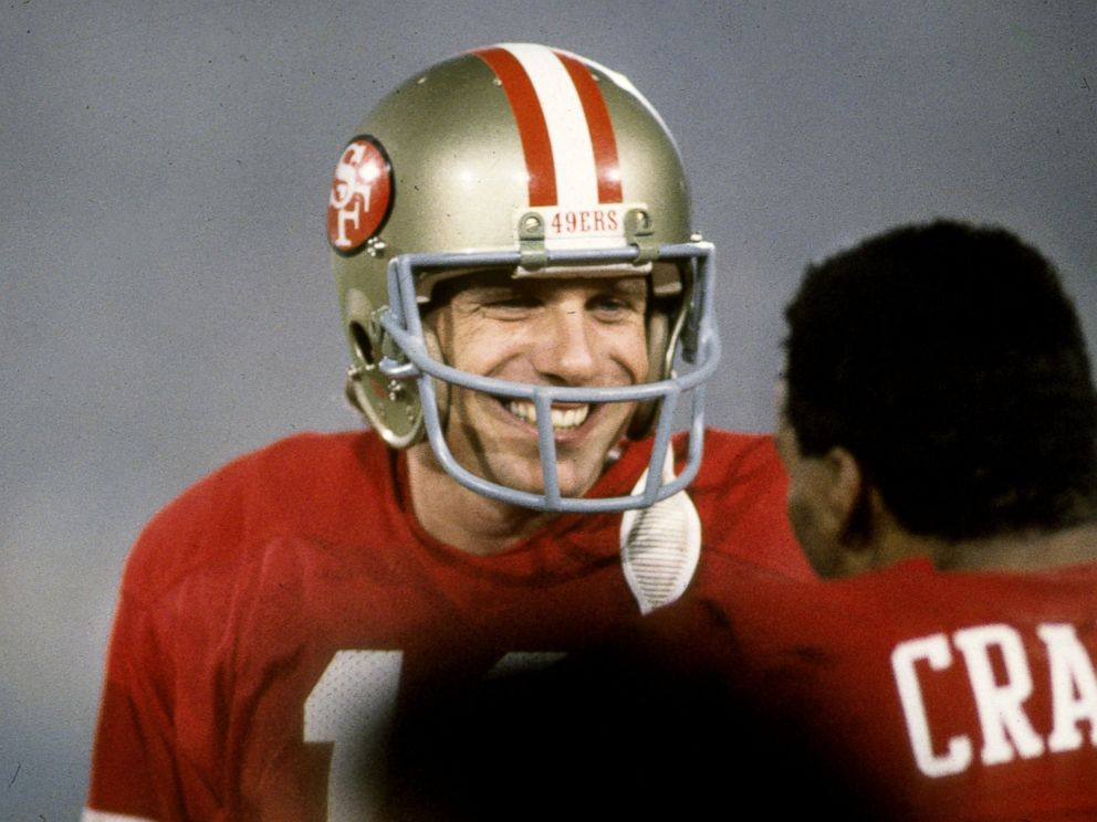 PHOTO: San Francisco 49ers Hall of Fame quarterback Joe Montana is all smiles as he talks to running back Roger Craig during Super Bowl XIX, Jan. 20, 1985, at Stanford Stadium in Stanford, Calif.