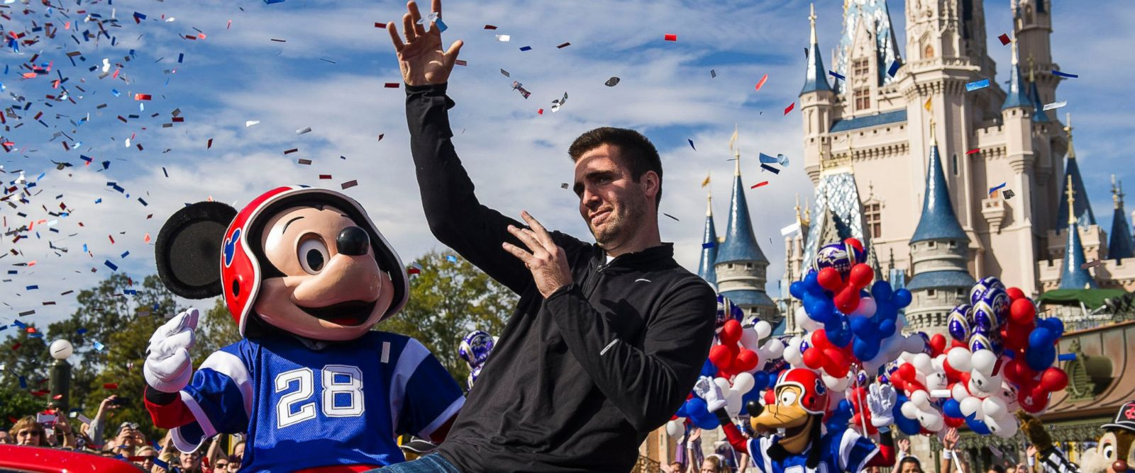 PHOTO: Super Bowl XLVII MVP Joe Flacco rides with Mickey Mouse in a parade through the Magic Kingdom at Walt Disney World Resort, Feb. 4, 2013 in Lake Buena Vista, Fla.