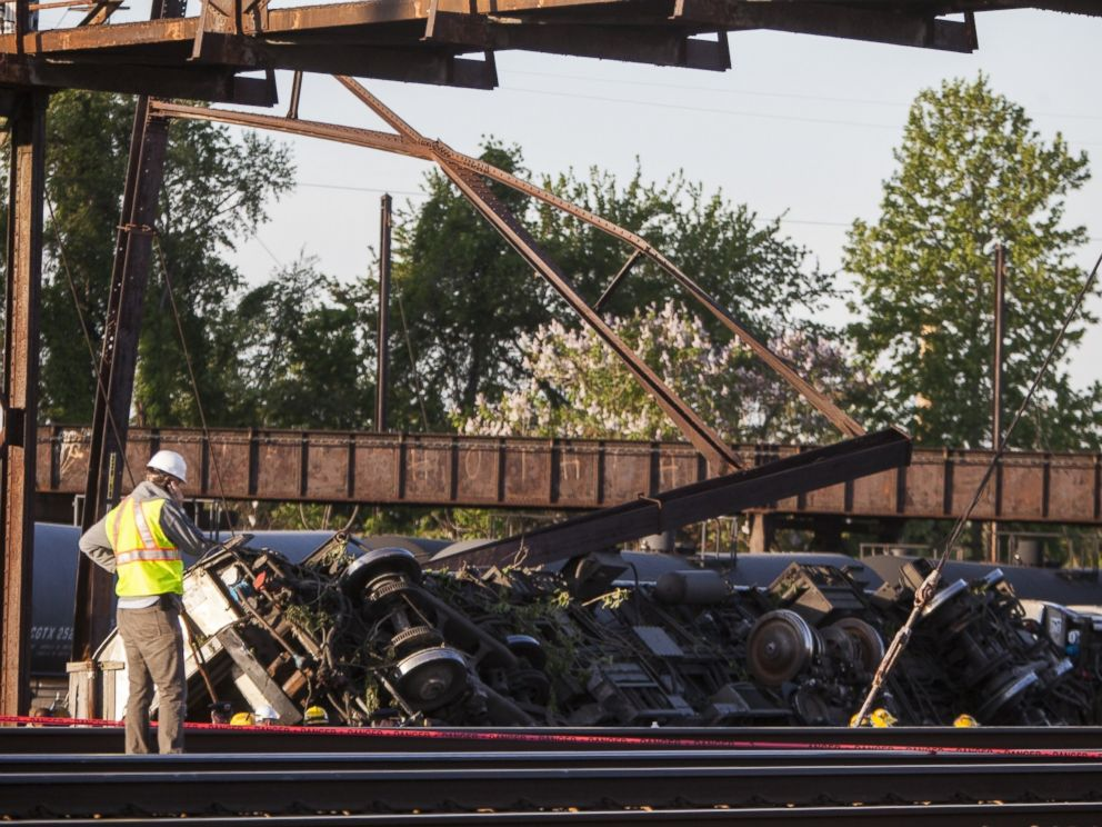 PHOTO: Rescue crews and investigators inspect the site of an Amtrak train derailment in Philadelphia, May 13, 2015.