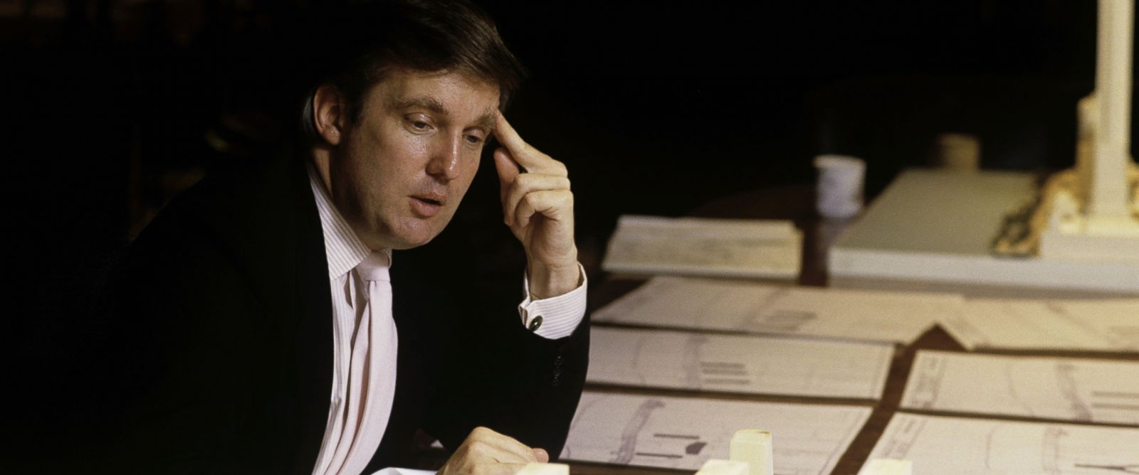 PHOTO: Donald Trump, real estate mogul, entrepreneur, and billionare spends most of his day attending board meetings in which he manages the construction of his buildings in his offices on August 1987 in New York City.