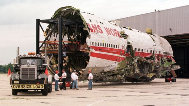 PHOTO: The partially reconstructed fuselage of TWA Flight 800 which crashed shortly after takeoff from JFK Airport in New York in August of 1996 is pulled out of a hangar Sept. 14, 1999 in Calverton, NY.