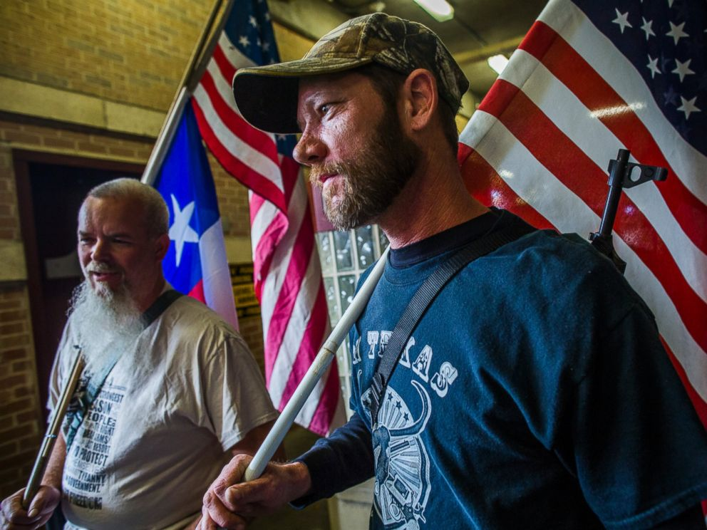 PHOTO: Jason Moseley (right) and Phil Neumann along with other pro-gun activists march close to The University of Texas campus, Dec. 12, 2015 in Austin, Texas