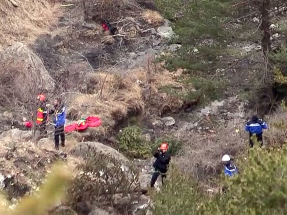 PHOTO:A screengrab taken from an AFP TV video on March 24, 2015 shows search and rescue personnel making their way to the crash site of the Germanwings Airbus A320 that crashed in the French Alps above the southeastern town of Seyne.