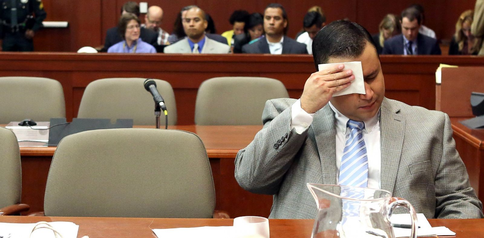 PHOTO: George Zimmerman wipes his brow