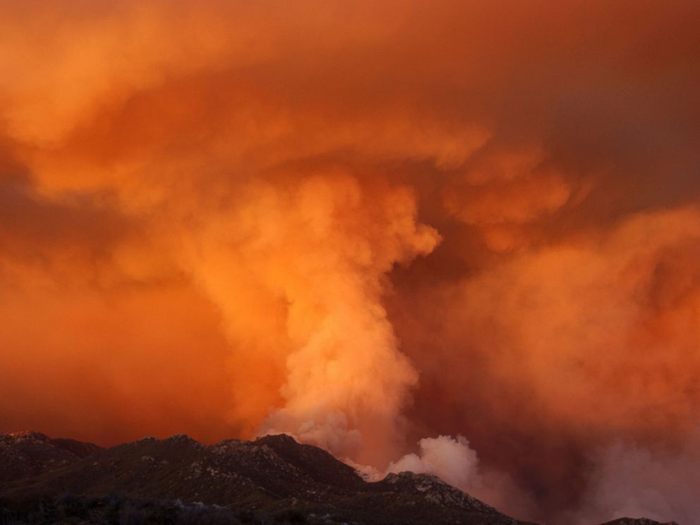 PHOTO: Smoke takes on the appearance of a colossal tornado as it rises from upper Borrego Palm Canyon in the Anza-Borrego Desert State Park near the boundary of the Los Coyotes Indian Reservation August 7, 2002 west of Borrego Springs, California.