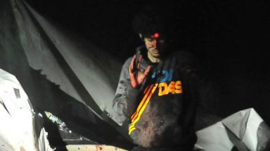 PHOTO: A sniper trains his bead on Dzhokhar Tsarnaev on April 19, 2014 him in Watertown, Mass.