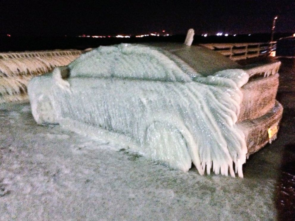 PHOTO: A car off Route 5 in Buffalo froze over from waters from Lake Eerie Sunday night and Monday morning.