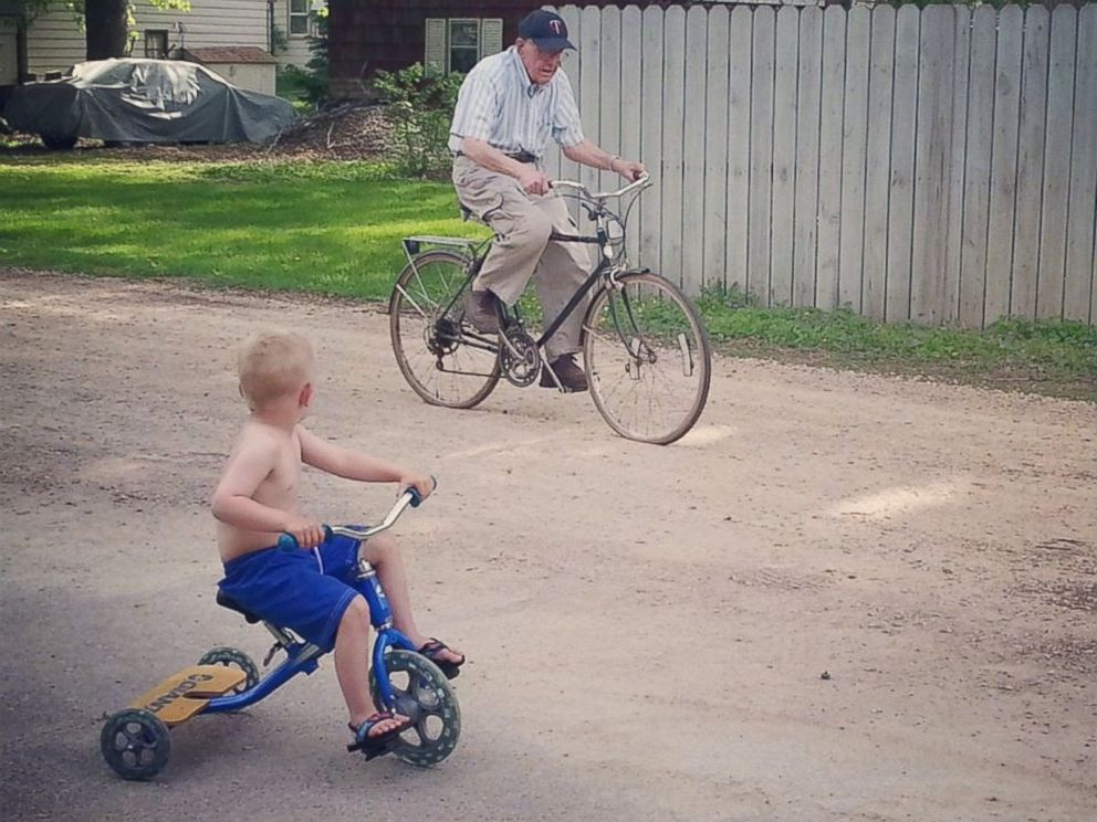 PHOTO: Emmett, left, and Erling biking together near the house.
